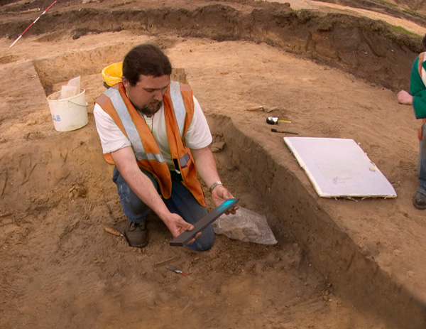 An AAS summer volunteer holds an artifact from the Gimbel Site. TheSite Preservation and Security Committee administers theArksite Preservation Fund program to help protect sites for future generations