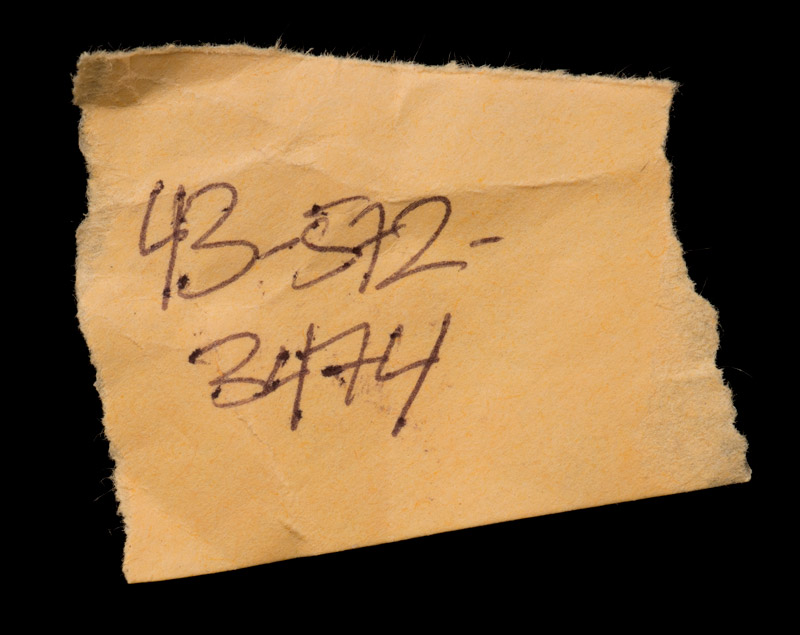 Scrap of paper with phone number found in the Jarndyke Ark